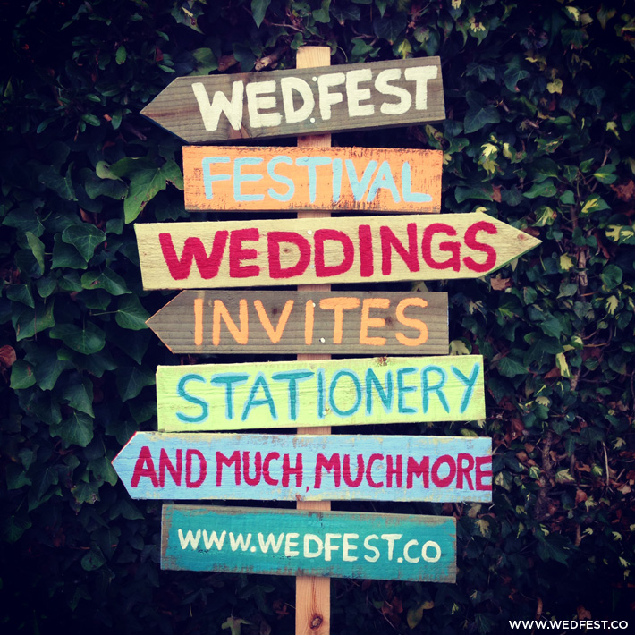 festival wedding vintage wooden signpost