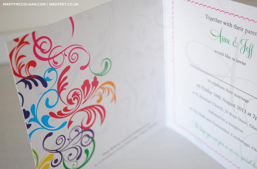 swirly rainbow coloured wedding invites