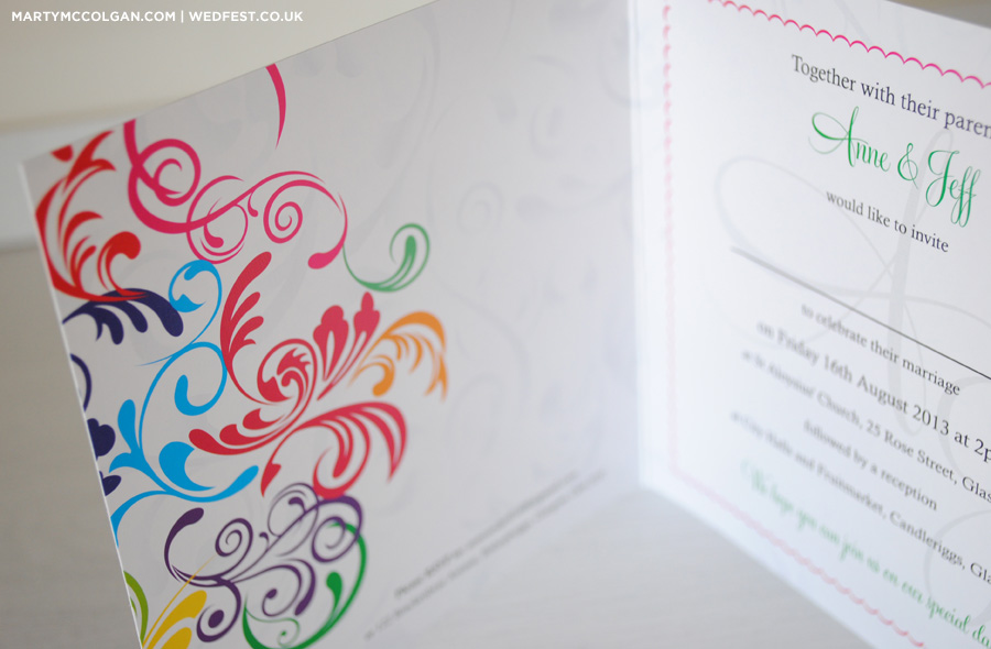 swirly rainbow coloured wedding invites