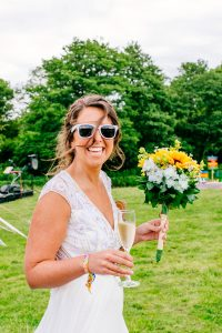 festival bride wearing her festival wristbands from wedfest