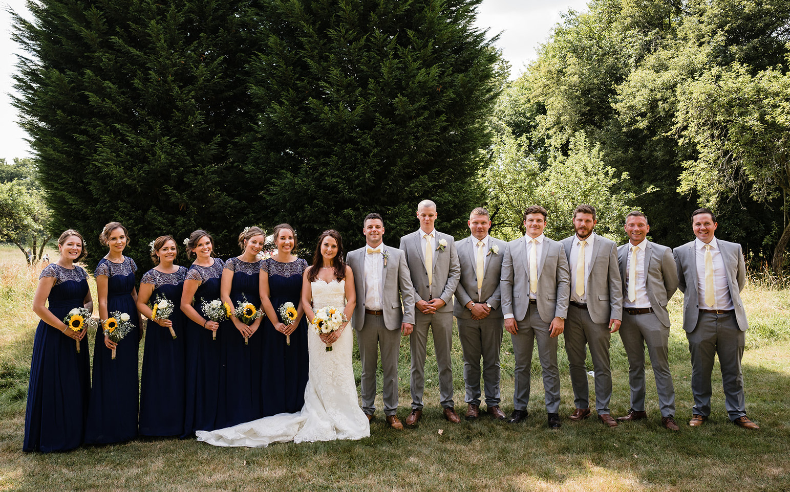 festival wedding bride groom bridesmaids groomsmen