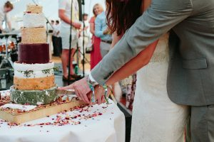 festival wedding cake and wristbands