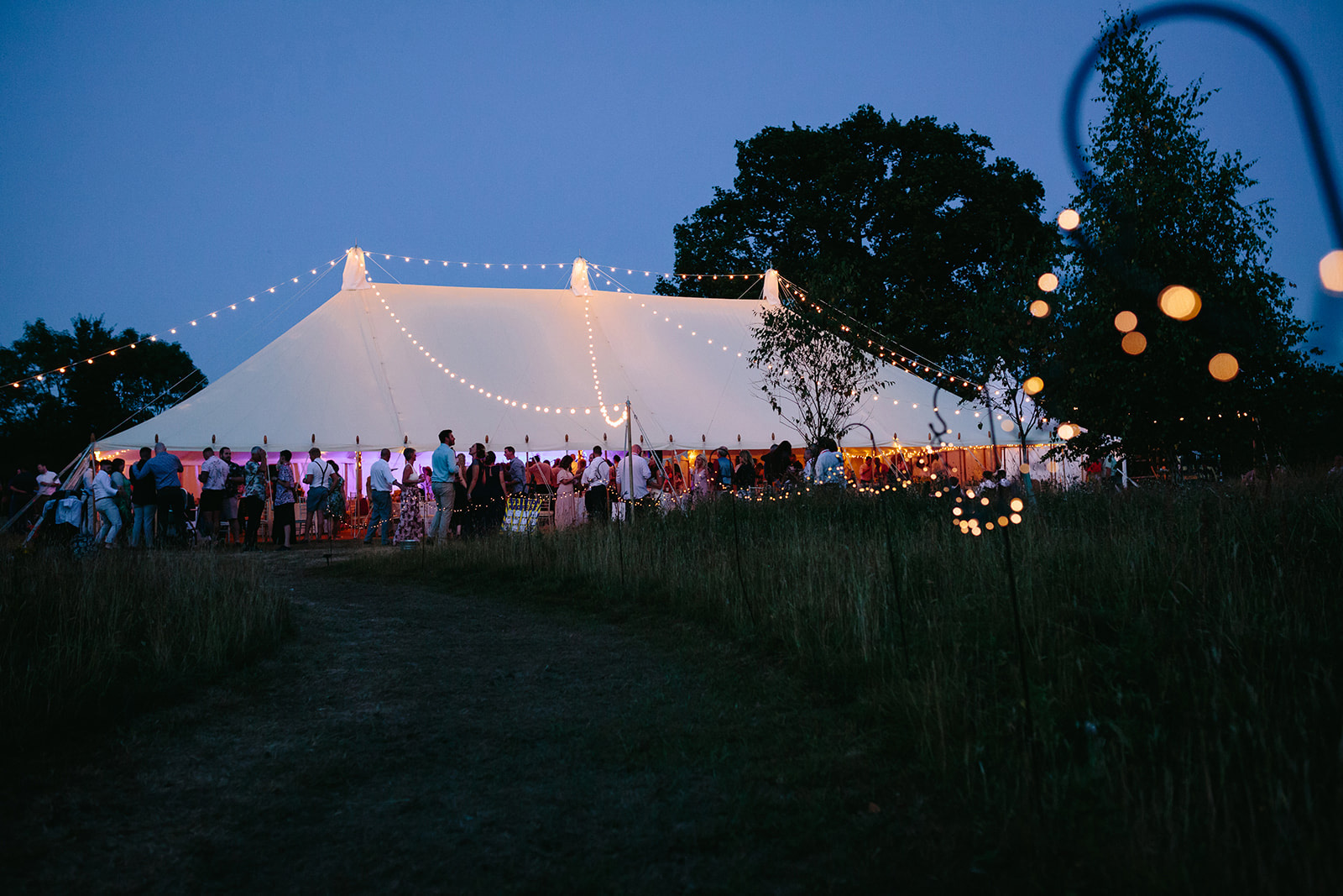 festival wedding tent night time