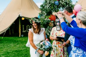 festival wedding tipi flower arch wristbands wedfest