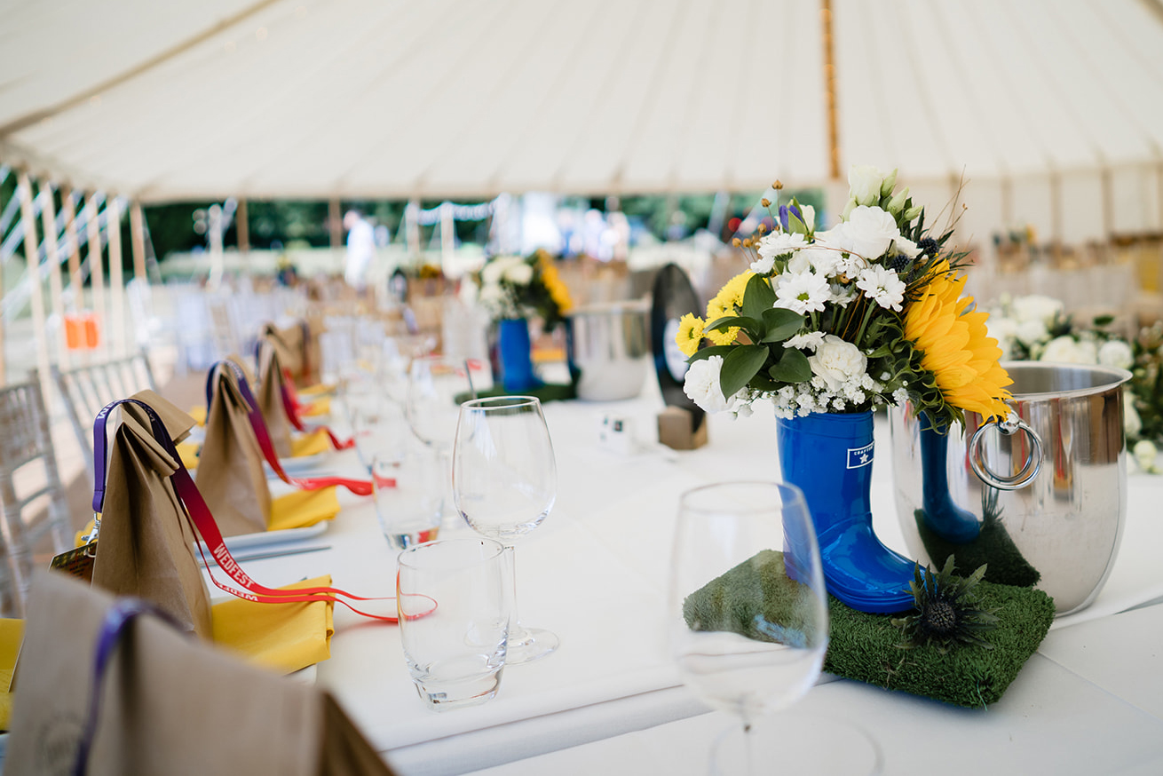 festival weddings table decorations flowers wellies