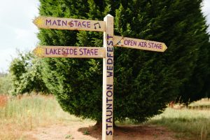 festival weddings wedfest wooden signage